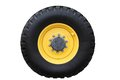 Yellow tractor wheel. Royalty Free Stock Photo