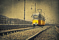 Yellow tram image of railroad tracks with Royalty Free Stock Photos