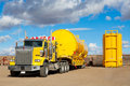 Yellow Transport With Oilfield Tanks Royalty Free Stock Image