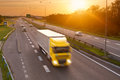 Yellow truck in the rush hour on the highway Royalty Free Stock Photo