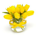 Yellow tulips in a glass vase Royalty Free Stock Image