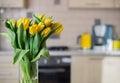 Yellow tulips on kitchen background fresh Royalty Free Stock Photo