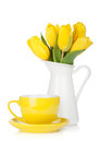 Yellow tulips and tea cup Stock Photography