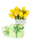 Yellow tulips tea cup and gift box isolated on white background Stock Image