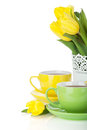 Yellow tulips and two tea cups Royalty Free Stock Image
