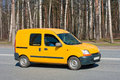 Yellow van on road Royalty Free Stock Photo