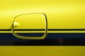 Yellow vehicle fuel filler cap closeup detail Royalty Free Stock Images
