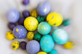 Yellow, violet, blue and green Easter egge with had drawings of butterflies, polka dots, spirals Royalty Free Stock Photo