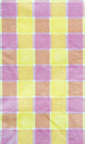 Yellow violet pink checkered tablecloth background texture Stock Image