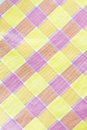 Yellow violet pink checkered tablecloth background texture Stock Photography