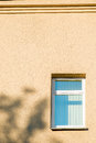 Yellow wall and a window Royalty Free Stock Photo