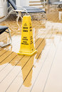 Yellow Warning Cone On Wet Deck
