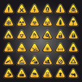 Yellow warning and danger signs Stock Photo
