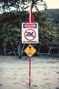 Yellow warning sign of marine stingers no swimming and queensland australia Royalty Free Stock Photos