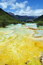 Yellow water on the mountains in huanglong beauty spot Stock Photography