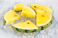 Yellow watermelon in ice cubes Royalty Free Stock Photo
