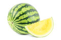 Yellow watermelon with a section on white Royalty Free Stock Image
