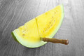 Yellow watermelon on vintage wooden table Stock Photography