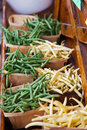 Yellow wax beans and green string beans in baskets a colorful display of tossed small bushel are on display at a farmers roadside Royalty Free Stock Photography