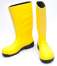 Yellow wellington boots on white background Stock Photos