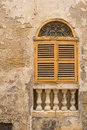Yellow window with an arch and shutter, island Malta Royalty Free Stock Photo