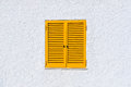 Yellow window shutters and white wall Royalty Free Stock Photo