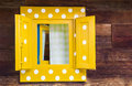 Yellow window on wooden house Royalty Free Stock Photo