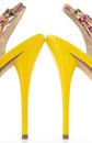 Yellow women stiletto shoes high heels, isolated Stock Photo