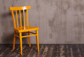 Yellow wooden chair in nterior room Royalty Free Stock Photo