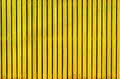 Yellow wooden painted fence Royalty Free Stock Photo