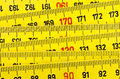 Yellow wooden zigzag rule closeup Royalty Free Stock Image