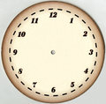 Yellowed, paper dial vintage clock with 12 numerals and without arrows. Restored. On a white background Royalty Free Stock Photo