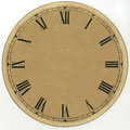 Yellowed, paper dial vintage clock with Roman numerals and without arrows. Restored. On a white background Royalty Free Stock Photo