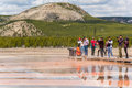 Yellowstone National Park, USA - May 17, 2016: Tourists taking pictures from boardwalk in Grand Prismatic spring in Midway Geyser Royalty Free Stock Photo