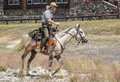 Yellowstone park ranger a on horseback watching the crowds at olf faithful in national in wyoming Stock Images