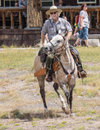 Yellowstone park ranger a on horseback watching the crowds at olf faithful in national in wyoming Royalty Free Stock Image