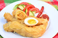 Yemeni food jachnun classic a classic jewish meal of grated tomatos boiled egg red hot pepper and salad usually served Royalty Free Stock Images