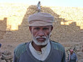 Yemeni portrait the of a senior man in the site of baraqish in the desert Stock Photo