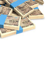 Yen notes scattered pile a of randomly wads of japanese banknotes on an isolated background Royalty Free Stock Image