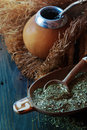 Yerba mate tea south american dried leaves in wooden bowl with a wooden calabash with Stock Images