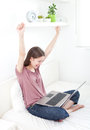 Yes excited young woman with her laptop Stock Photography