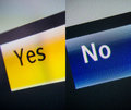 Yes and no words on a digital display close up tilt shift lens used for a better impact Royalty Free Stock Photos