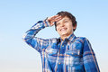 Yes sir a teenage boy is saluting and giving a big smile Stock Photos