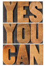 Yes you can motivational slogan isolated text in vintage letterpress wood type printing block rectangular layout Royalty Free Stock Photography
