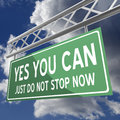 Yes you can words on road sign green just do not stop now Stock Image