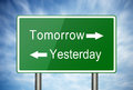 Yesterday and tomorrow a green road sign with text arrows Stock Images