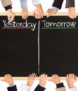 Yesterday tomorrow photo of business hands holding blackboard and writing and Stock Images