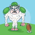 Yeti rugby player with a funny face with ball bat in the hat Royalty Free Stock Photo