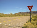 Yield on empty desert road in nevada Stock Photography