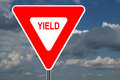 Yield Sign with clouds Stock Photography